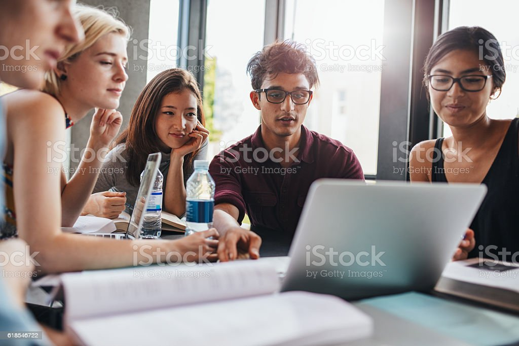 Students studying in university library stock photo