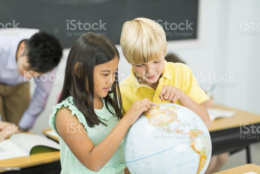Students Studying the Globe royalty-free stock photo