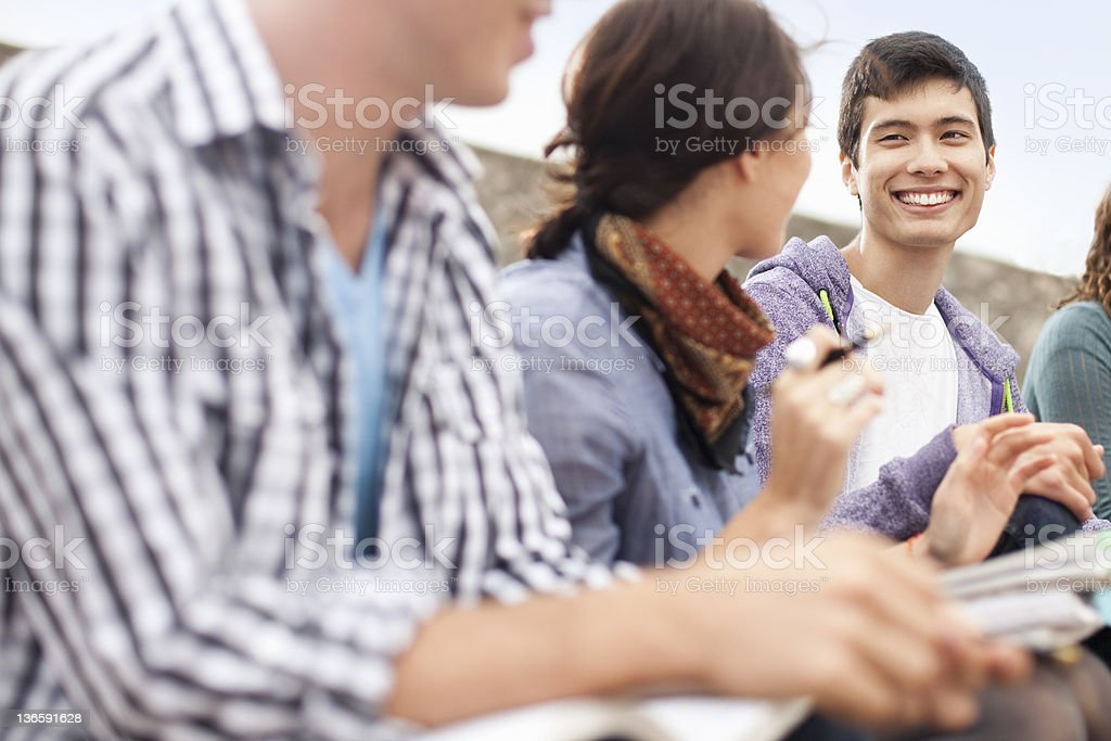 Students studying together outdoors royalty-free stock photo
