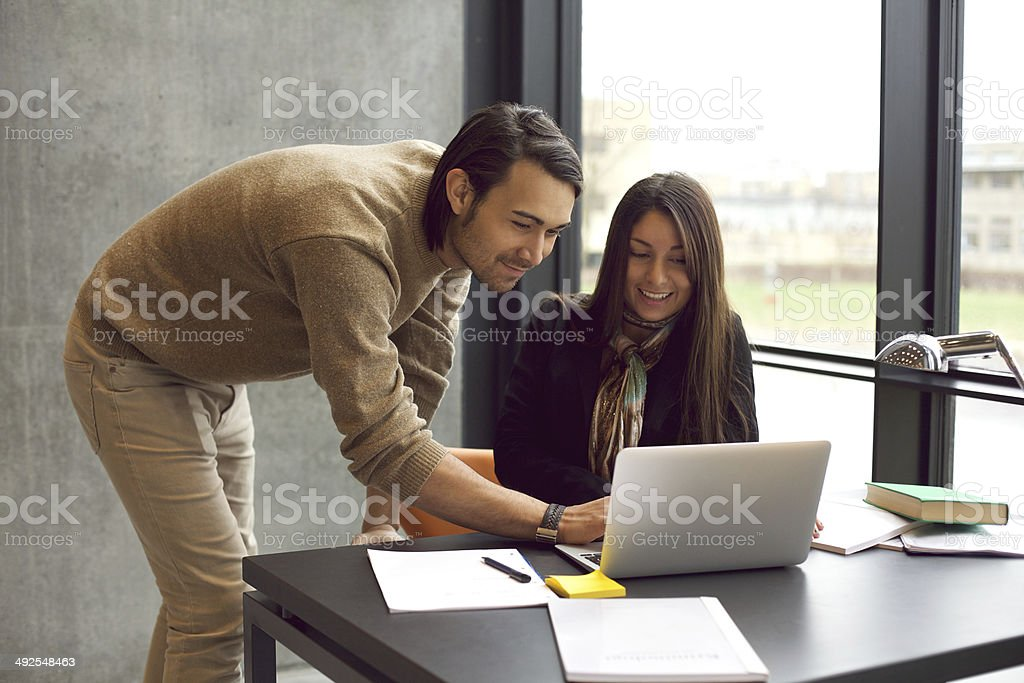 Students studying together with laptop stock photo
