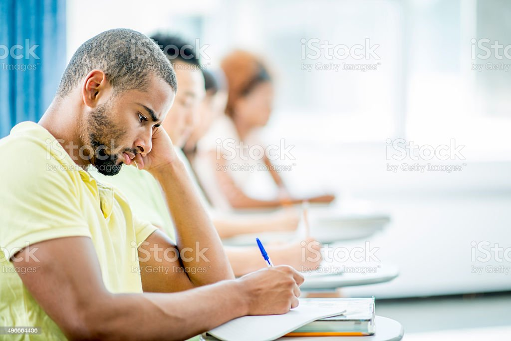 Students Taking a College Exam stock photo