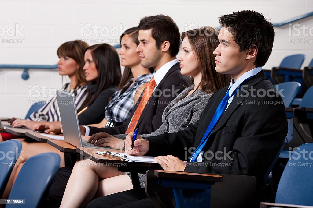 Students Taking Notes in Classroom stock photo