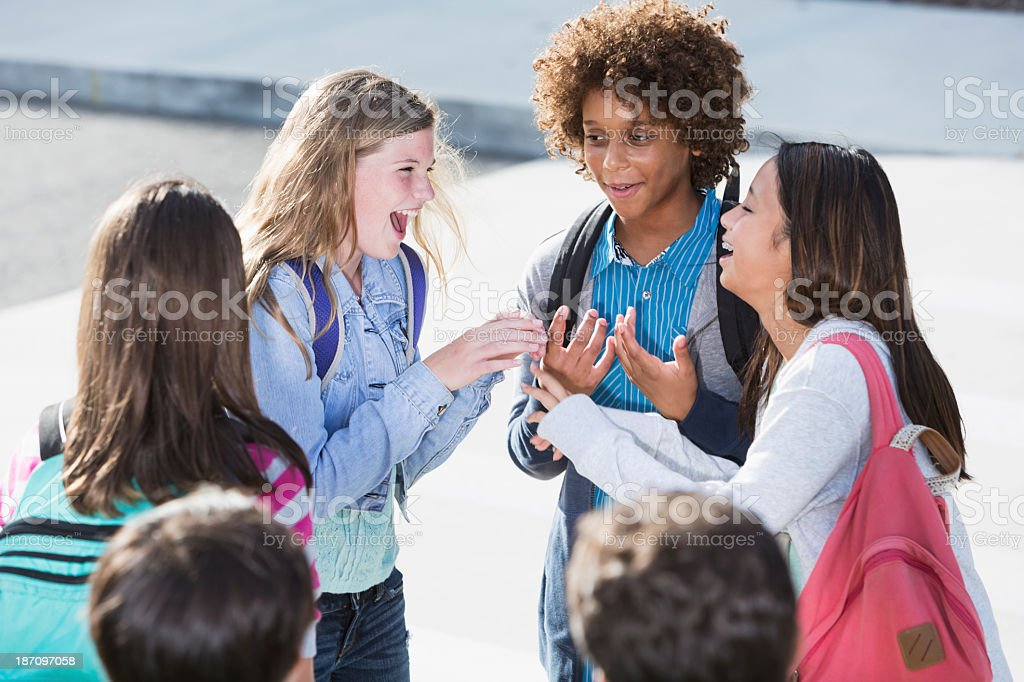 Students talking outdoors stock photo