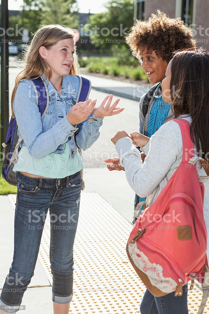 Students talking outside school royalty-free stock photo