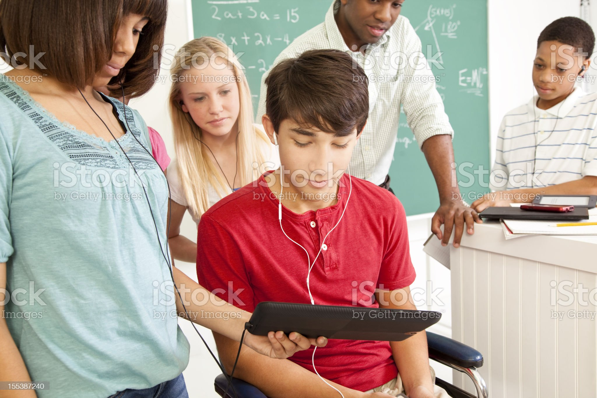 Students, teacher math classroom. Technology. Digital tablet. Child in wheelchair. royalty-free stock photo
