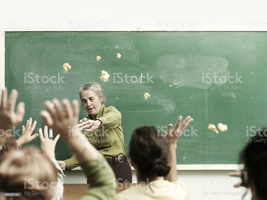 Students throwing papers stock photo