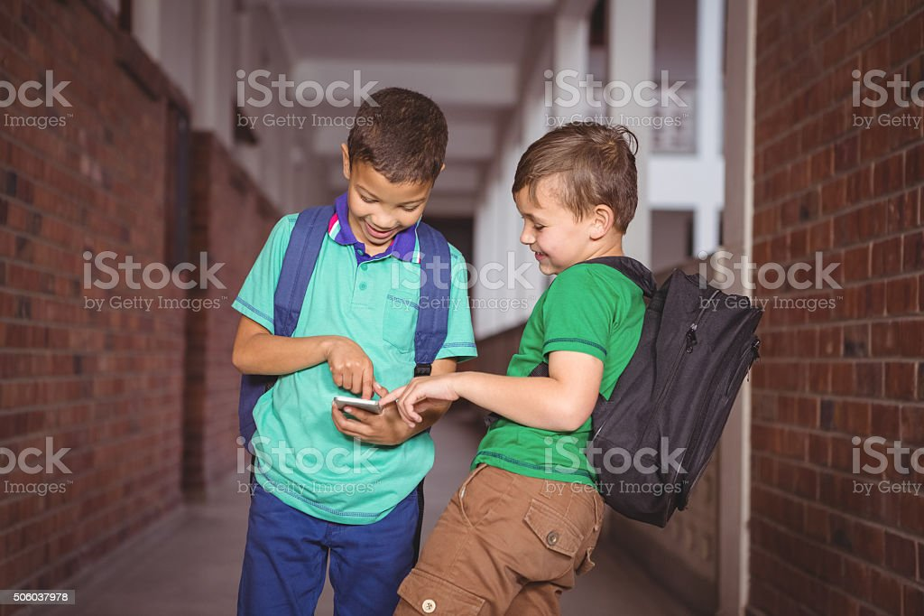 Students using a mobile phone stock photo