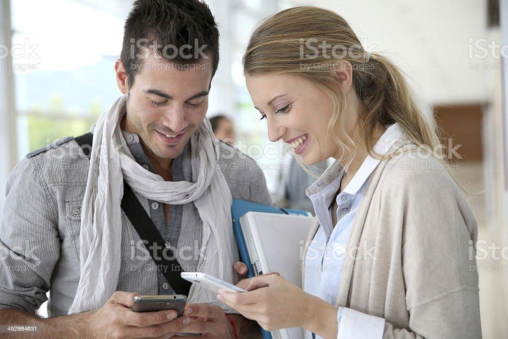 Students using smartphones stock photo