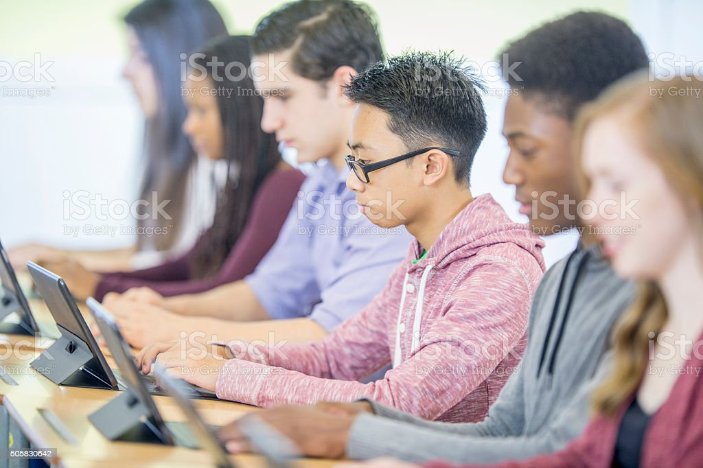 Students Using Tablets in the Computer Lab stock photo
