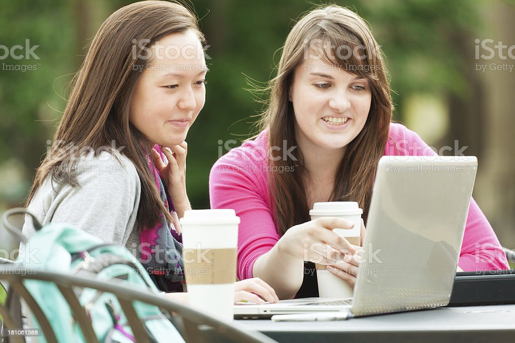 Students Using WIFI at Internet Cafe royalty-free stock photo