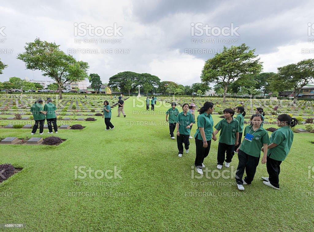 students visiting war cemetery of Kanchanaburi Thailand royalty-free stock photo