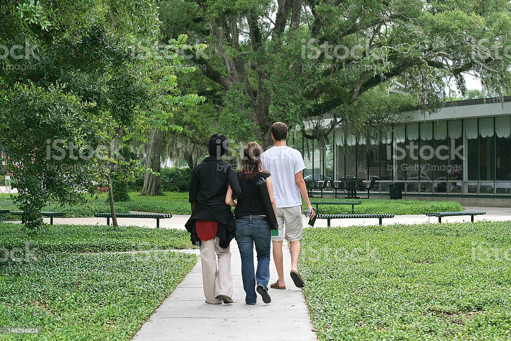 Students Walking Across Campus royalty-free stock photo