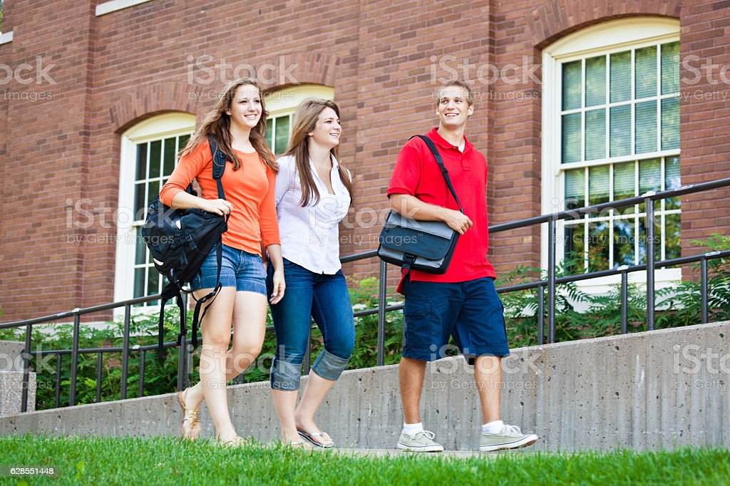 Students Walking by University Campus College Dorm stock photo