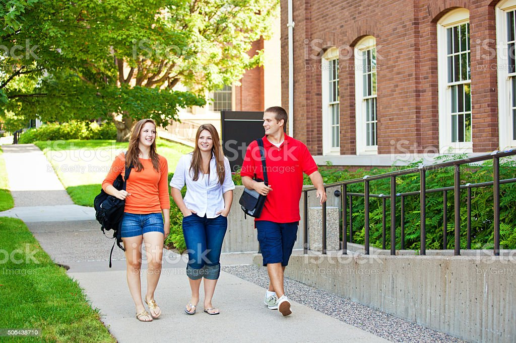 Students Walking by University Campus College Dorm, Talking about School stock photo