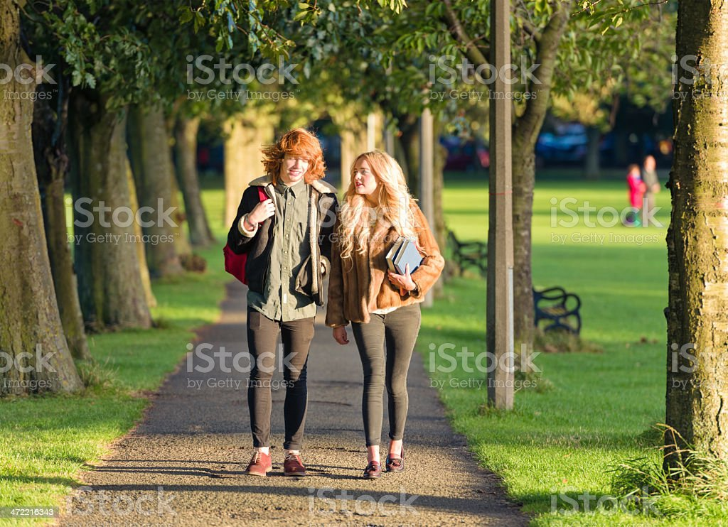 Students walking to lectures stock photo