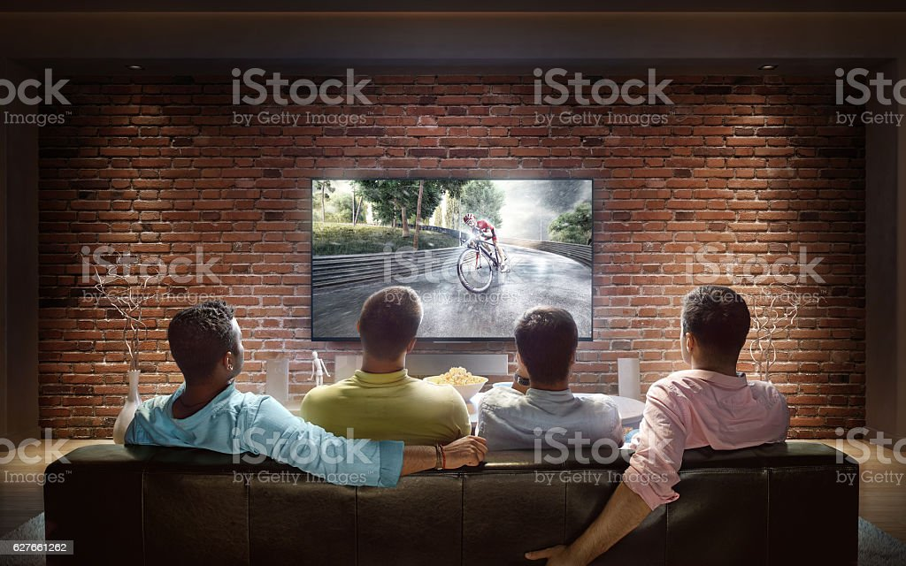 Students watching Bicycle race at home stock photo