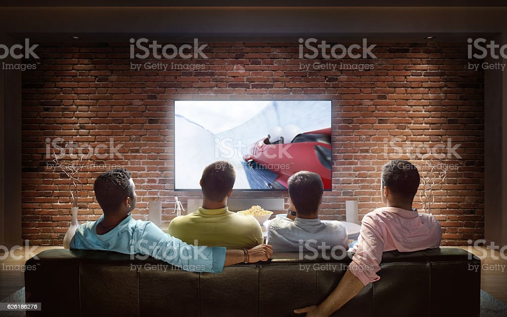 Students watching Bobsleigh competition at home stock photo