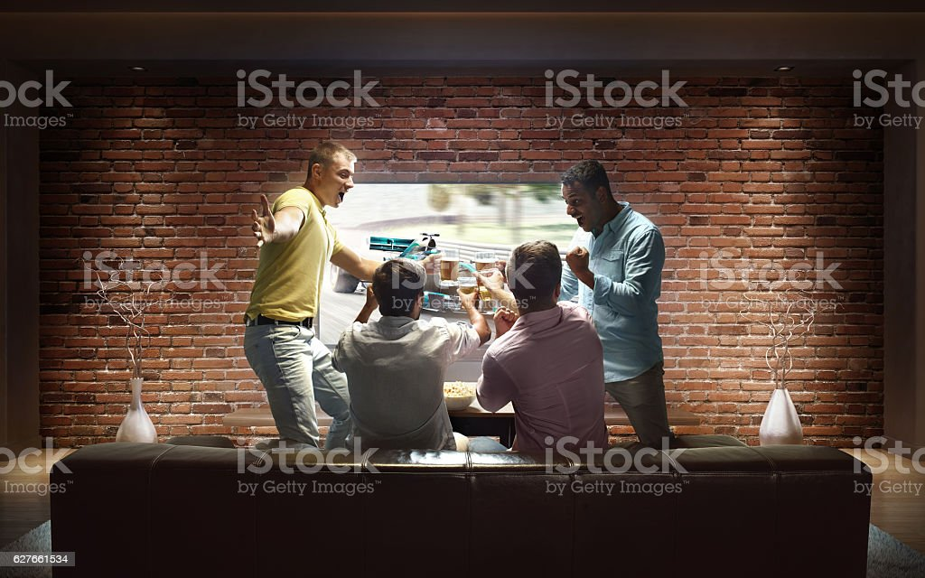 Students watching Car sprint at home stock photo