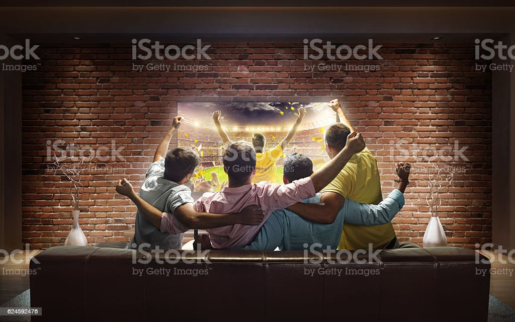 Students watching Sport game at home stock photo