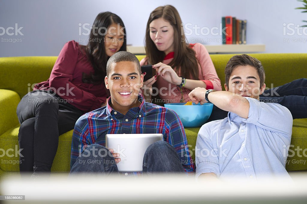 students watching tv royalty-free stock photo