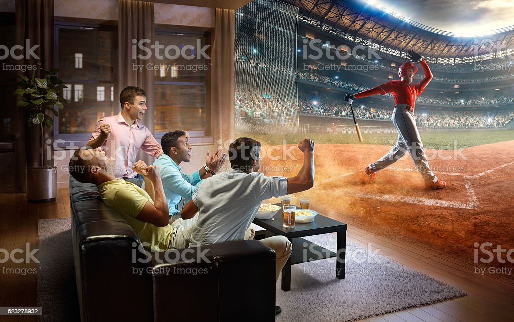 Students watching very realistic Baseball game at home stock photo