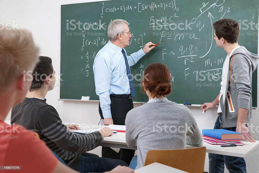 students with a teacher in classroom stock photo