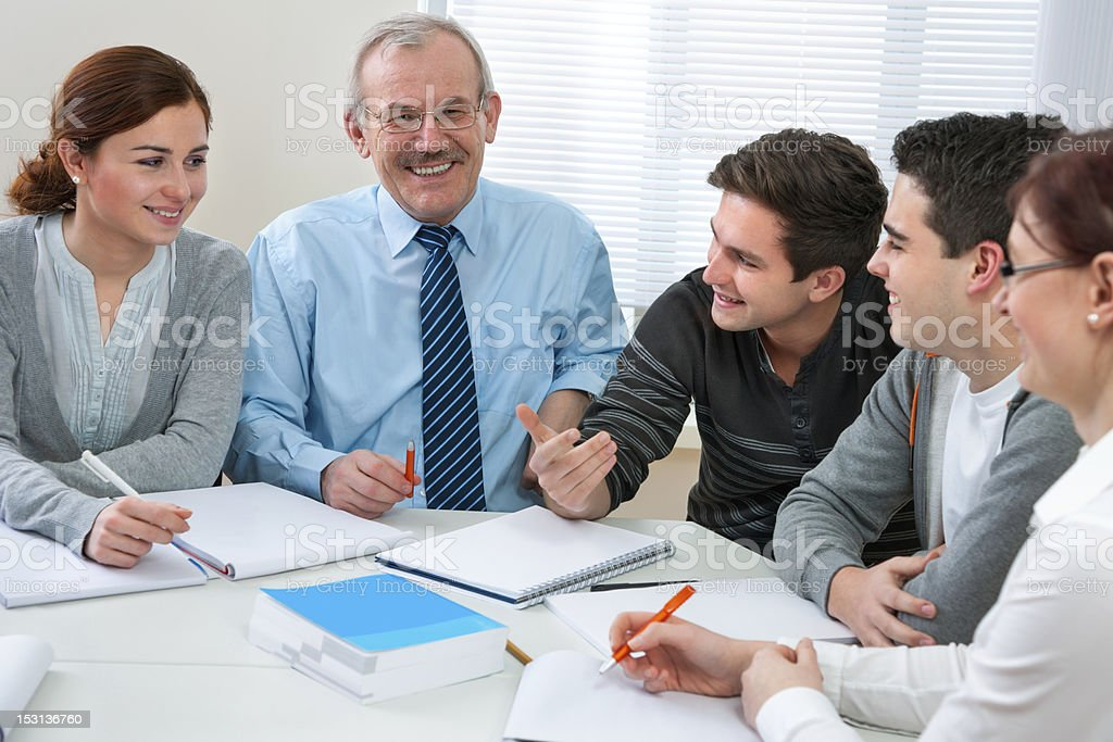 students with a teacher in classroom royalty-free stock photo