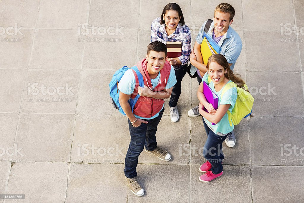 Students With Books And Binders On Campus royalty-free stock photo