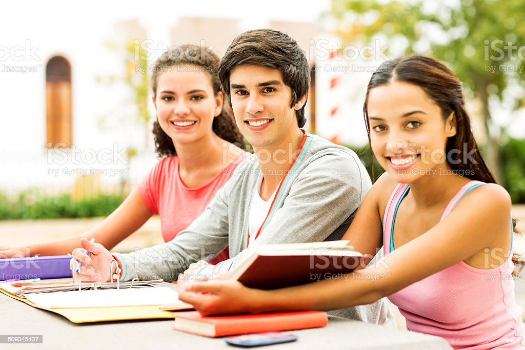 Students With Books And File Sitting At Table On Campus royalty-free stock photo