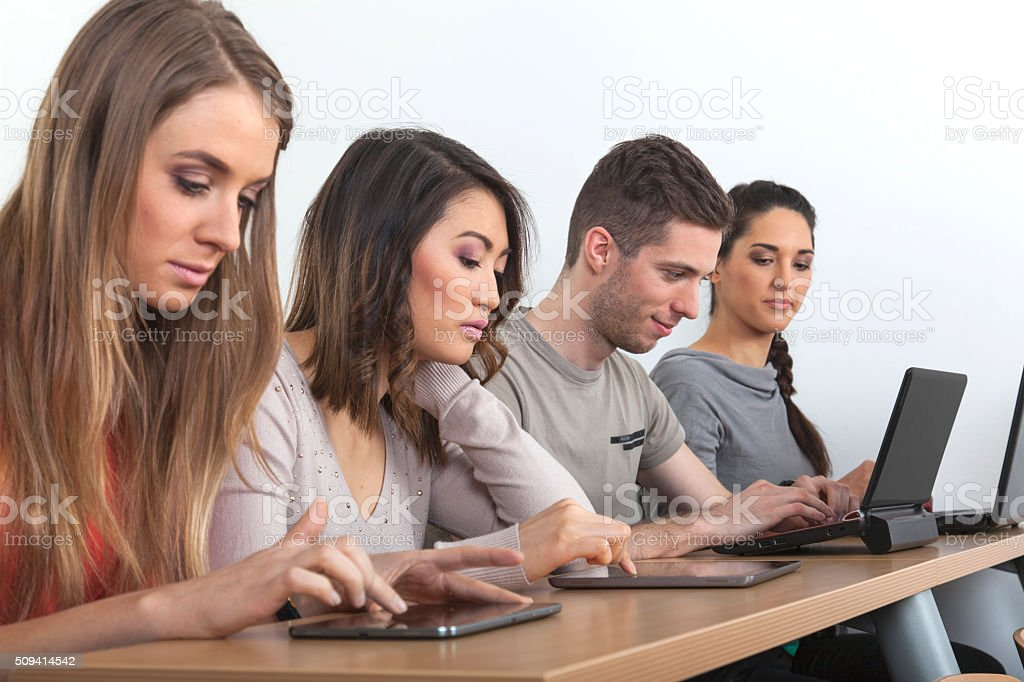 Students with laptops and tablets stock photo