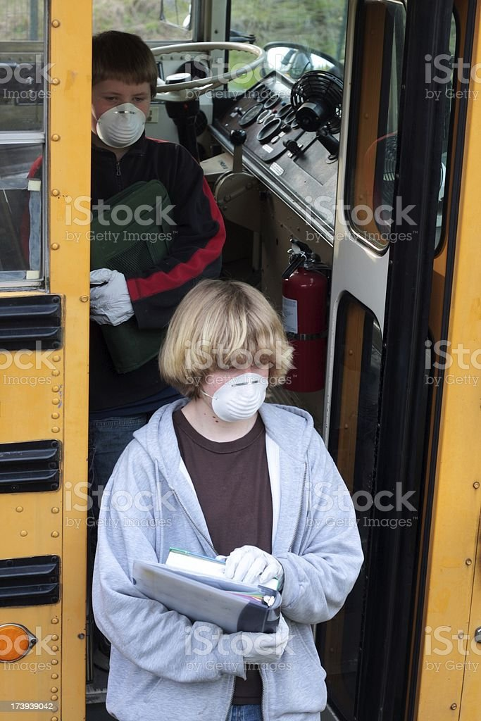 Students With Masks and Gloves Getting Off School Bus royalty-free stock photo