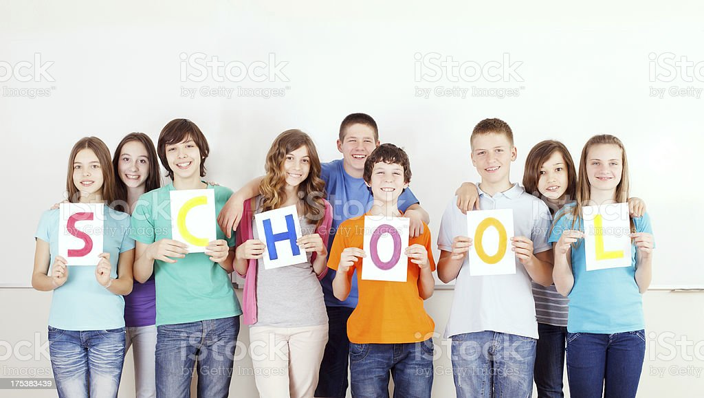 Students with  SCHOOL message on placards. royalty-free stock photo