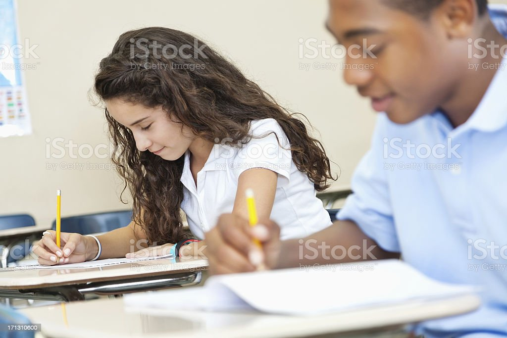 Students with uniforms working hard in class royalty-free stock photo