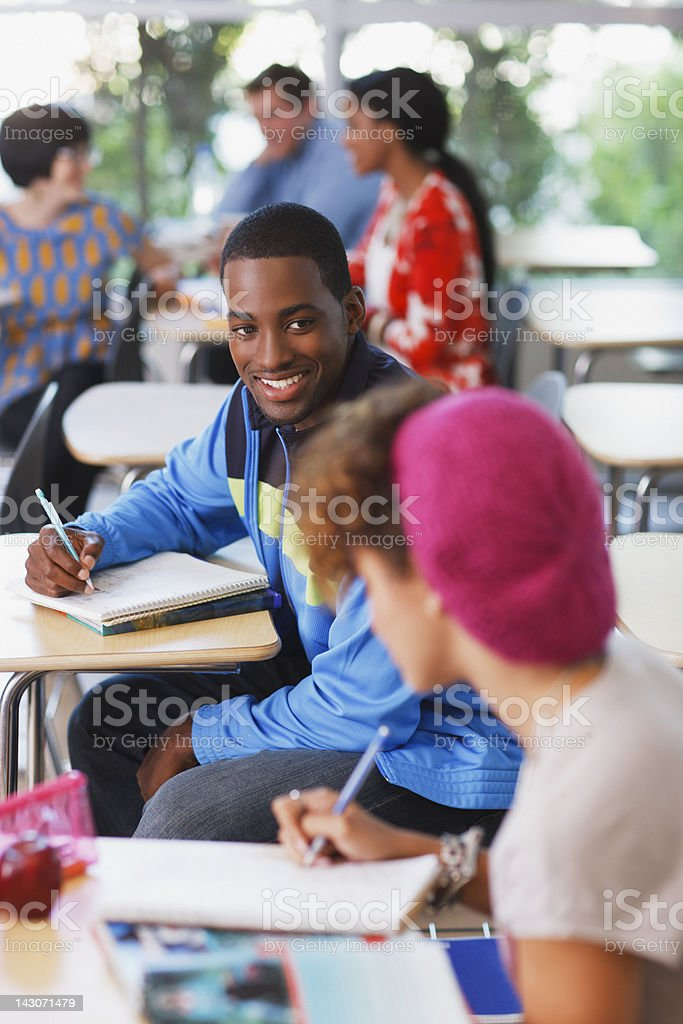 Students working at desks in classroom