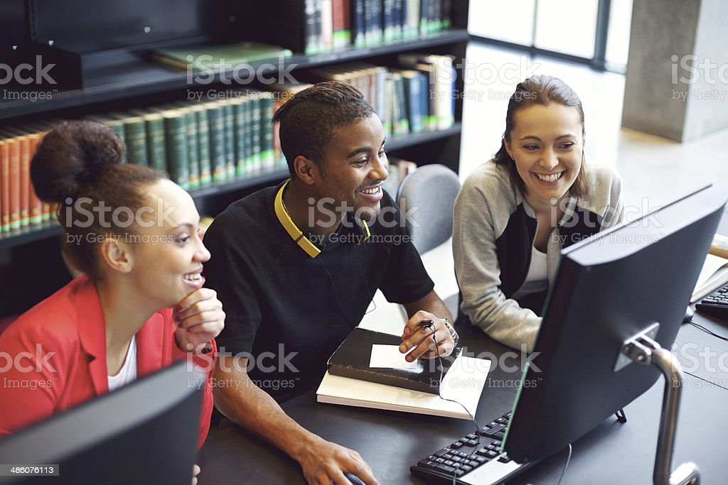 Students working on computer in a college library stock photo