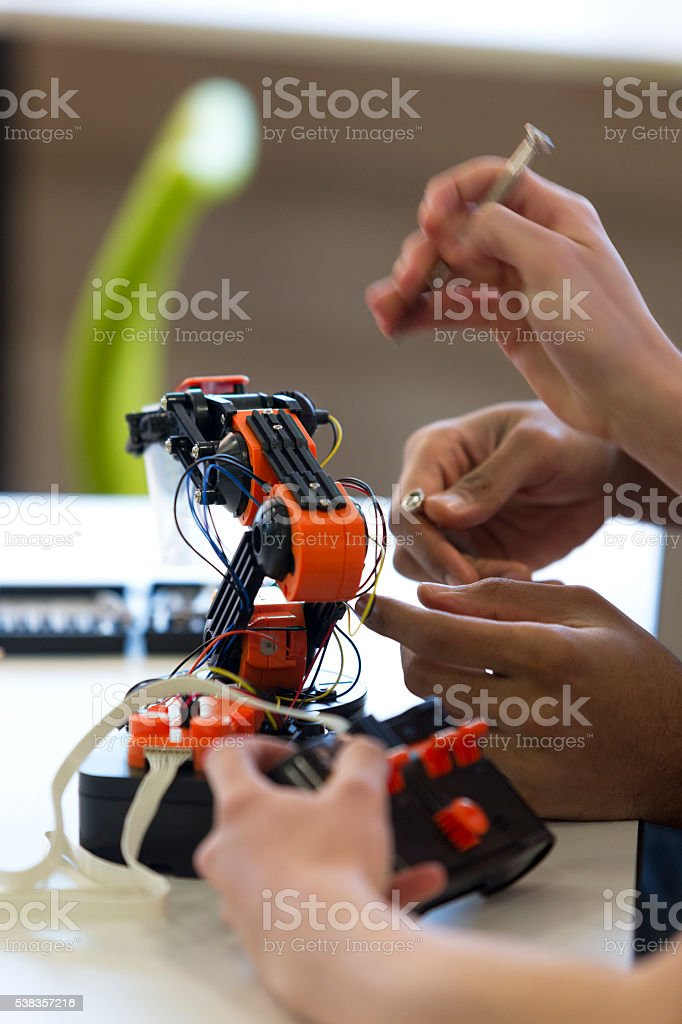 Students Working on Robotic Arm stock photo