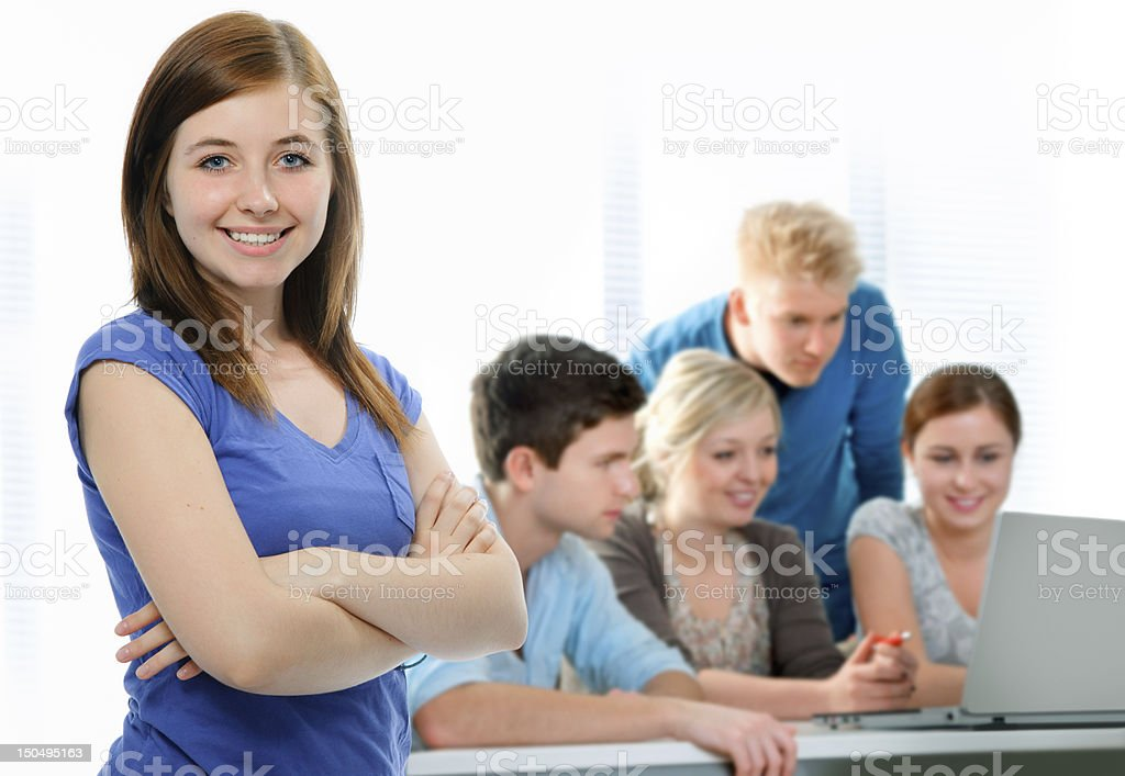 students working together in a classroom stock photo