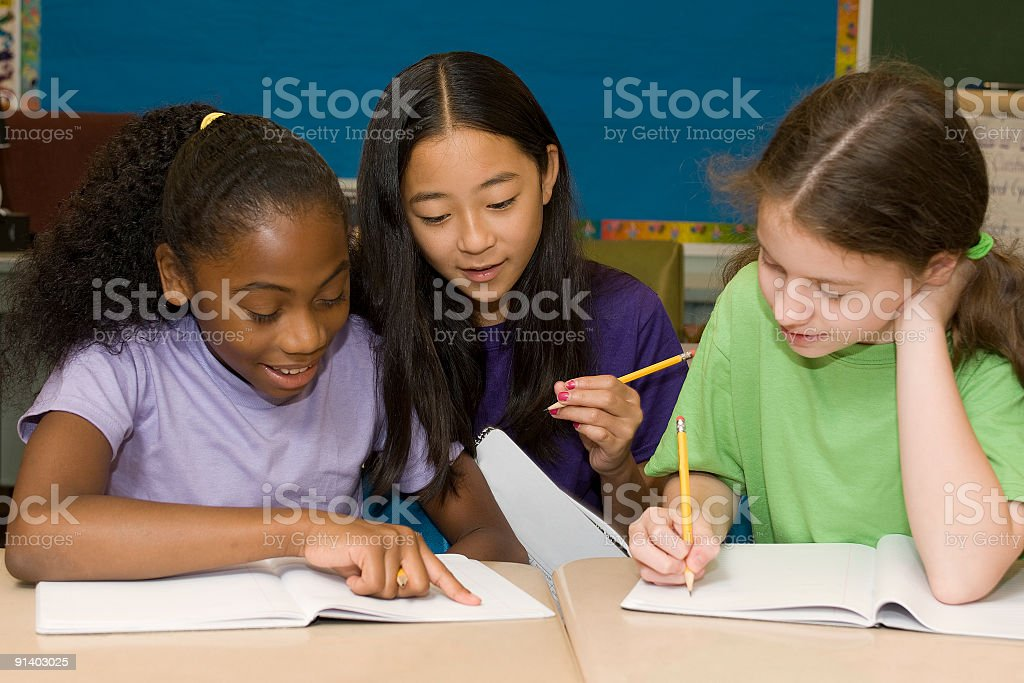 Students working together in a classroom royalty-free stock photo