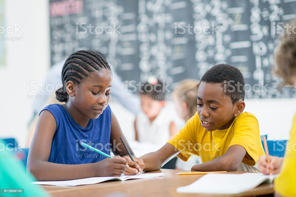 Students Working Together in Class stock photo