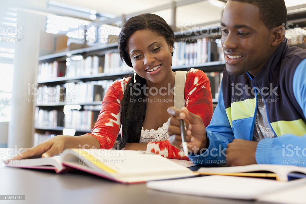 Students working together in library royalty-free stock photo