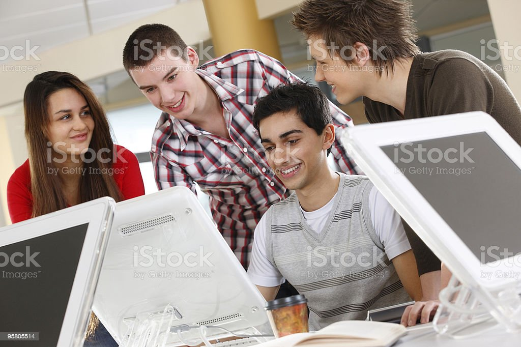 students working together on a computer in school classroom royalty-free stock photo