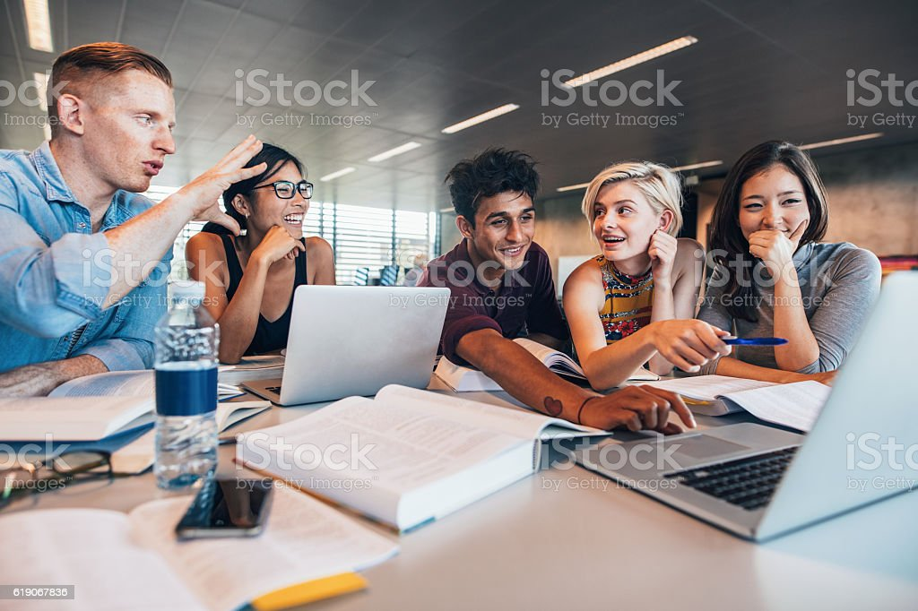 Students working together on academic project stock photo