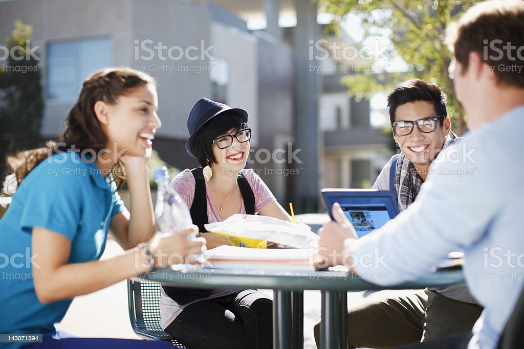Students working together outdoors stock photo