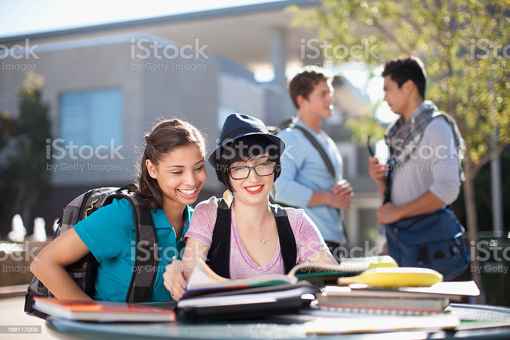 Students working together outdoors royalty-free stock photo