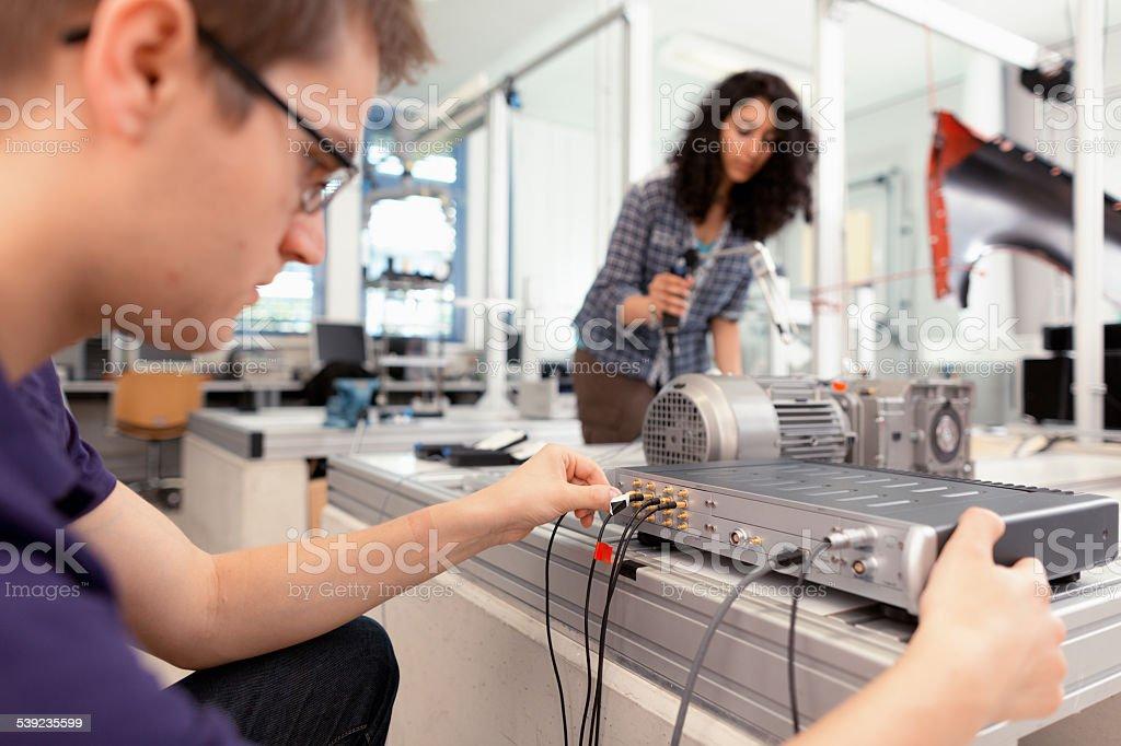 students working vibration technology stock photo