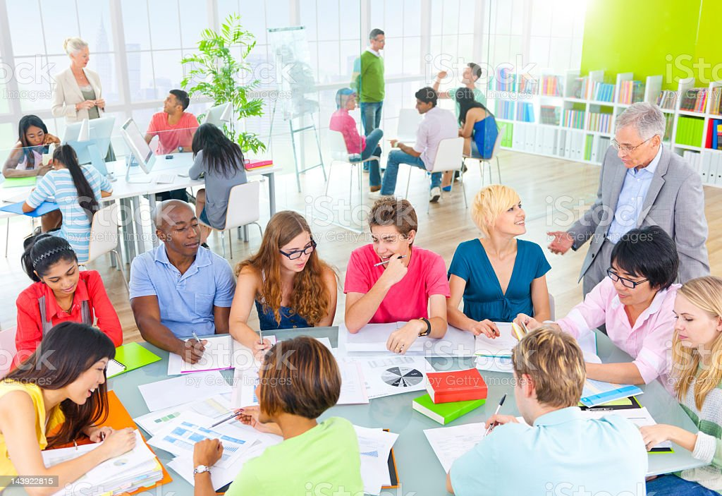 Students Working With Teacher. royalty-free stock photo
