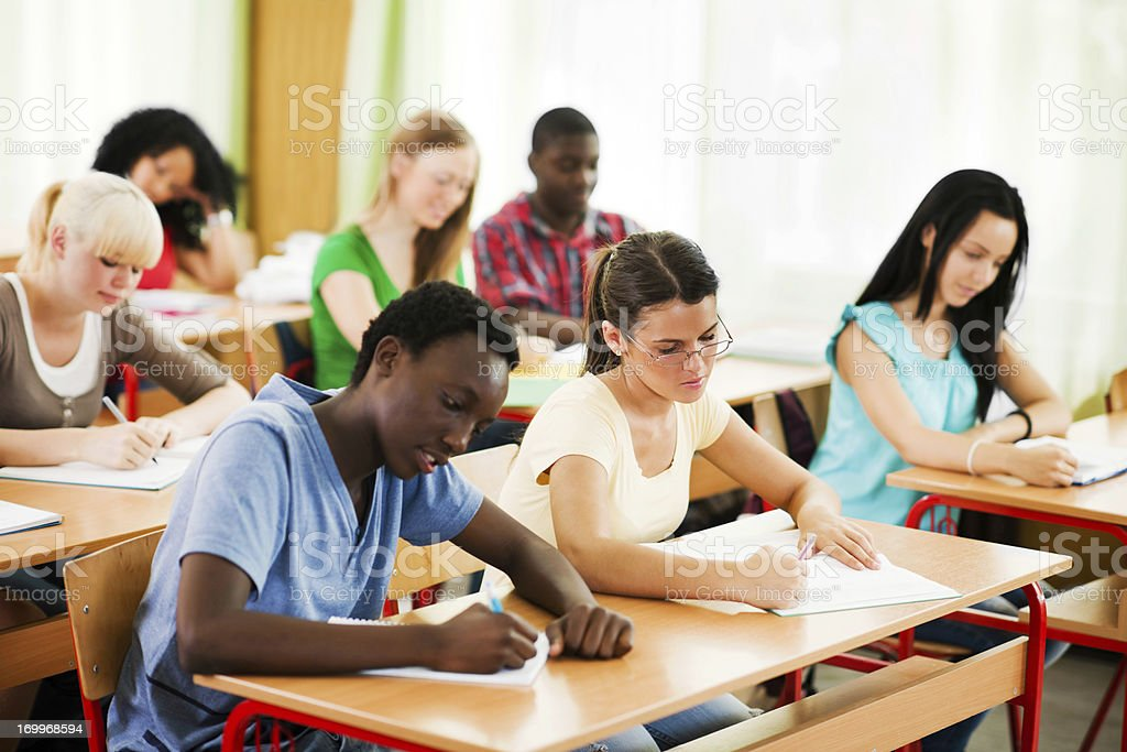 Students writing in their notebooks. royalty-free stock photo