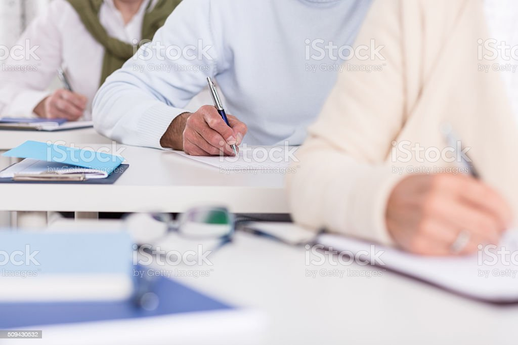 Students writing test stock photo
