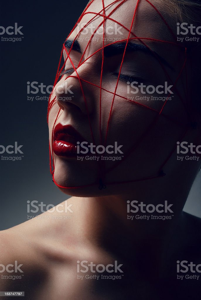 Studio beauty portrait of woman with red web on face royalty-free stock photo