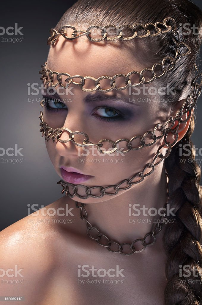 Studio beauty portrait with chains royalty-free stock photo